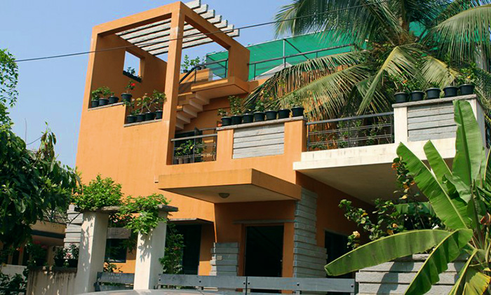 Pushpas House With Hibiscus On Every Railing Balcony Roof And All Around Her Yard